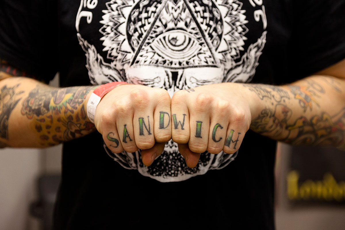 love and hate tattooed on the knuckles of his hands creative review. Black Bedroom Furniture Sets. Home Design Ideas