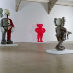 Installation shot of OriginalFake Companion (2006), Chum (pink) (2009), and Clean Slate (2014), KAWS (Photo: Jonty Wilde)