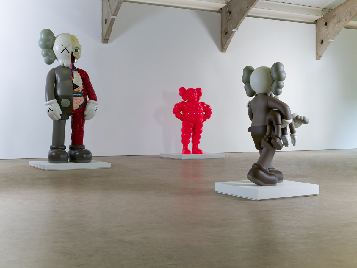 Installation shot of OriginalFake Companion (2006), Chum (pink) (2009), and Clean Slate (2014), KAWS (Photo: Jonty Wilde)