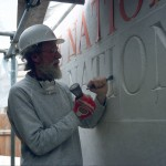 Michael Harvey carving letters into the National Gallery Sainsbury Wing