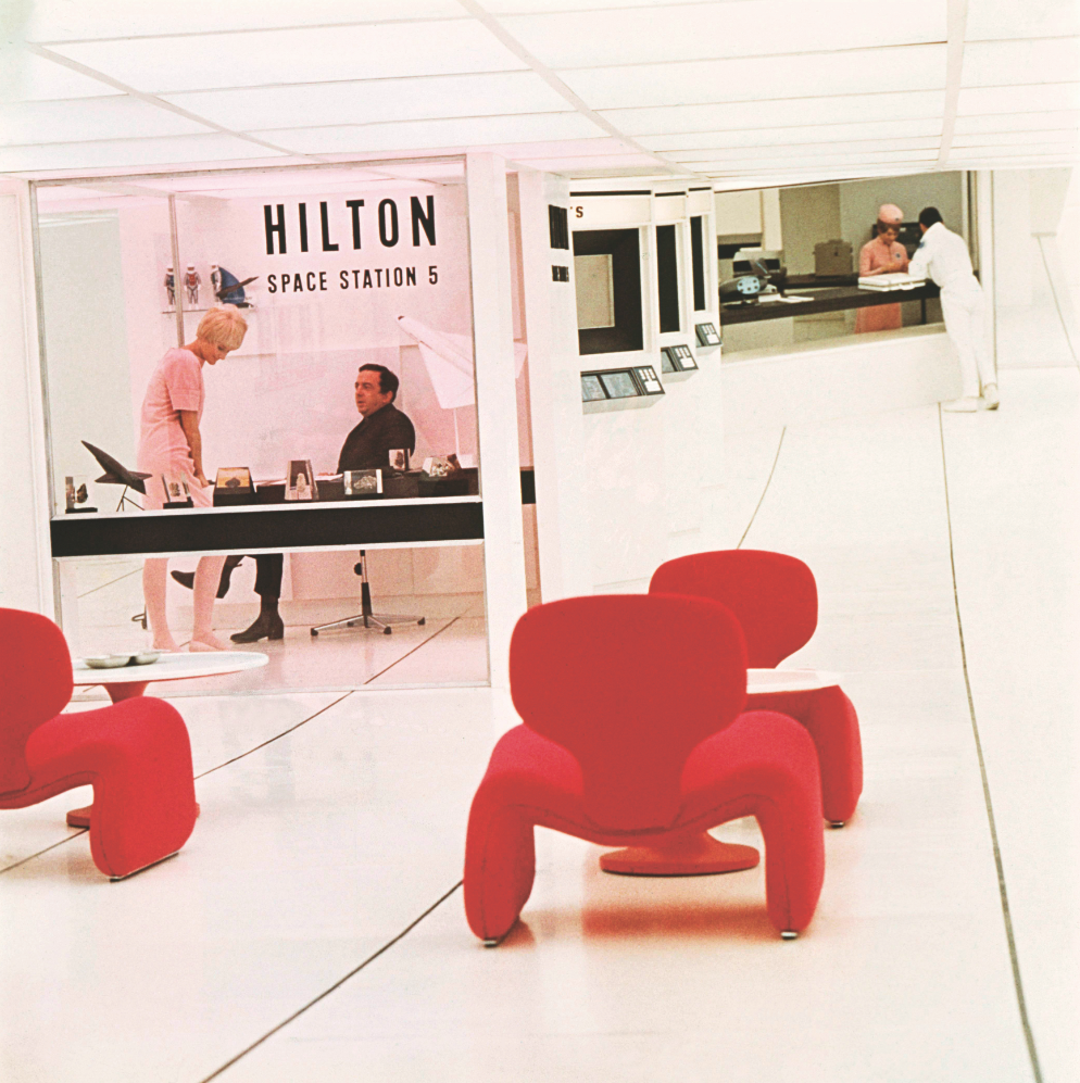 The Hilton hotel at Space Station 5, with its bright red Djinn chairs, originally designed by Olivier Mourgue in 1963. The film also featured Eero Saarinen's Tulip Table, a series of Geoffrey Harcourt-designed chairs and 'flatwear' cutlery by Arno Jacobsen (designed in 1957, produced in 1962). Photo: MGM/The Kobal Collection