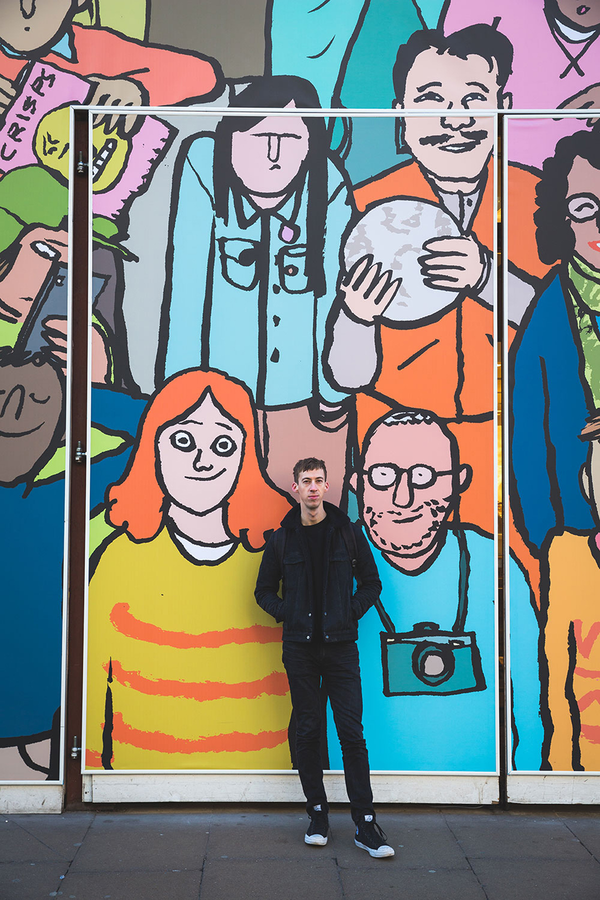 Photographs of Jean Jullien and his hoarding for Uniqlo, shot by Tom Robinson