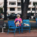 Taken in Cannes, France 2015. I took this photograph on Promenade de la Croisette, during my summer holiday. Whilst everyone is mostly new wealth, this woman stood out, as she is relatively modest in appearance, and accompanied by a dog, as well as being elderly. I found it amusing how the dog shared the same facial expression as the dog.
