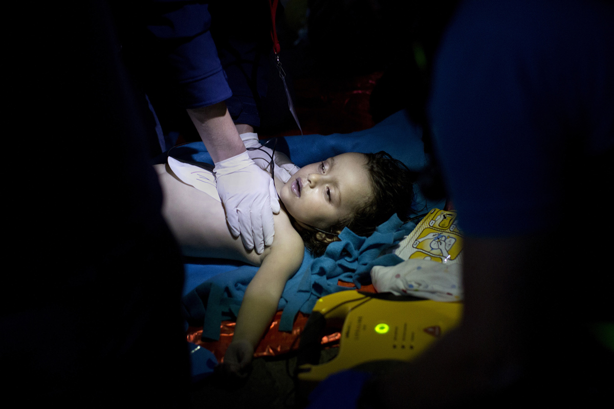 Doctors and paramedics try to revive a baby after boat with refugees and migrants sunk while attempting to reach the Greek island of Lesbos from Turkey, on October 28, 2015. At least five migrants including three children, died on October 28, 2015 after four boats sank between Turkey and Greece.
