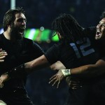 New Zealand's centre Ma'a Nonu (C) celebrates with New Zealand's lock Sam Whitelock (L) and New Zealand's wing Julian Savea (R) after scoring his team's second try during the final match of the 2015 Rugby World Cup between New Zealand and Australia at Twickenham stadium, south west London, on October 31, 2015. (Photo credit: Adrian Dennis/AFP Photo/Getty Images)