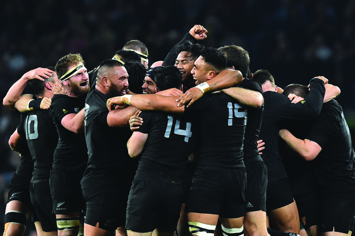 New Zealand's players celebrate after winning the final match of the 2015 Rugby World Cup between New Zealand and Australia at Twickenham stadium, south west London, on October 31, 2015.