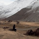 Photograph by Seamus Murphy. It depicts Polly Harvey in a valley in Afghanistan. [i'm sorry I don't recall the name of the place]. Polly and I chose this photograph for the gatefold in both vinyl and digipak. The spectacular scene is a surprise after the simple white cover.