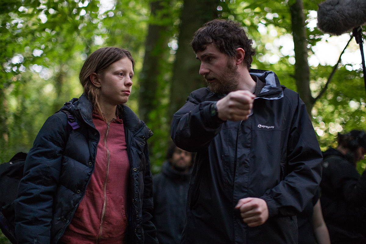 Director Stephen Fingleton on set of The Survivalist with Mia Goth