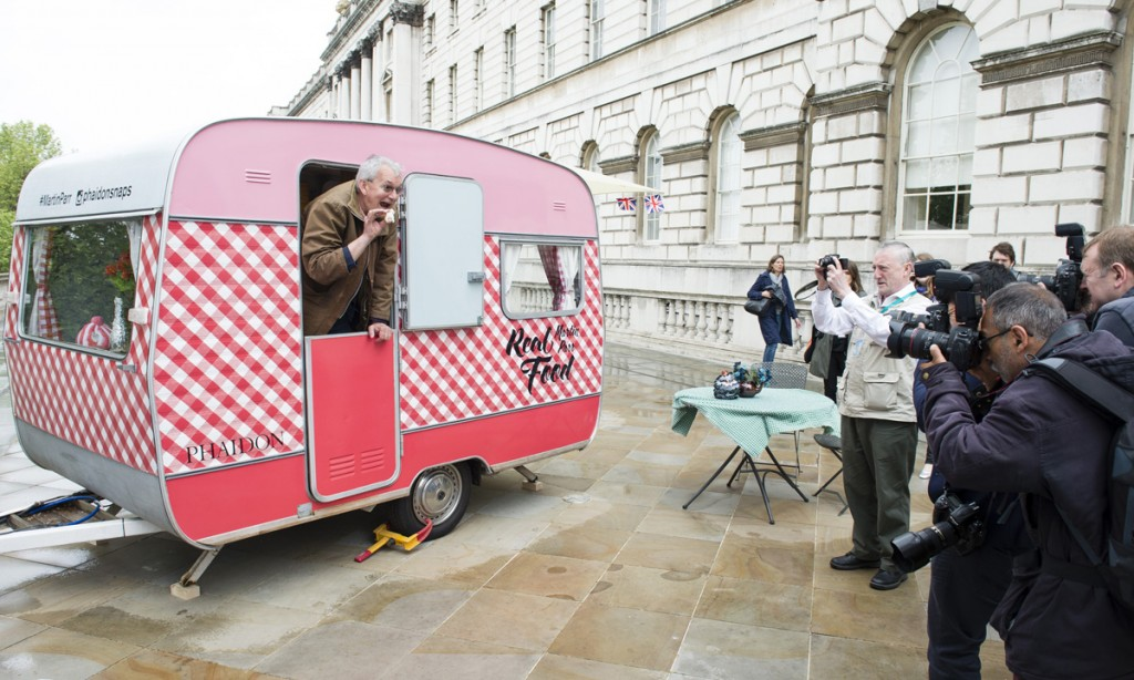 Martin Parr with his caravan installation at the opening of Photo London, (Photo by Jeff Spicer/Getty Images for Photo London)