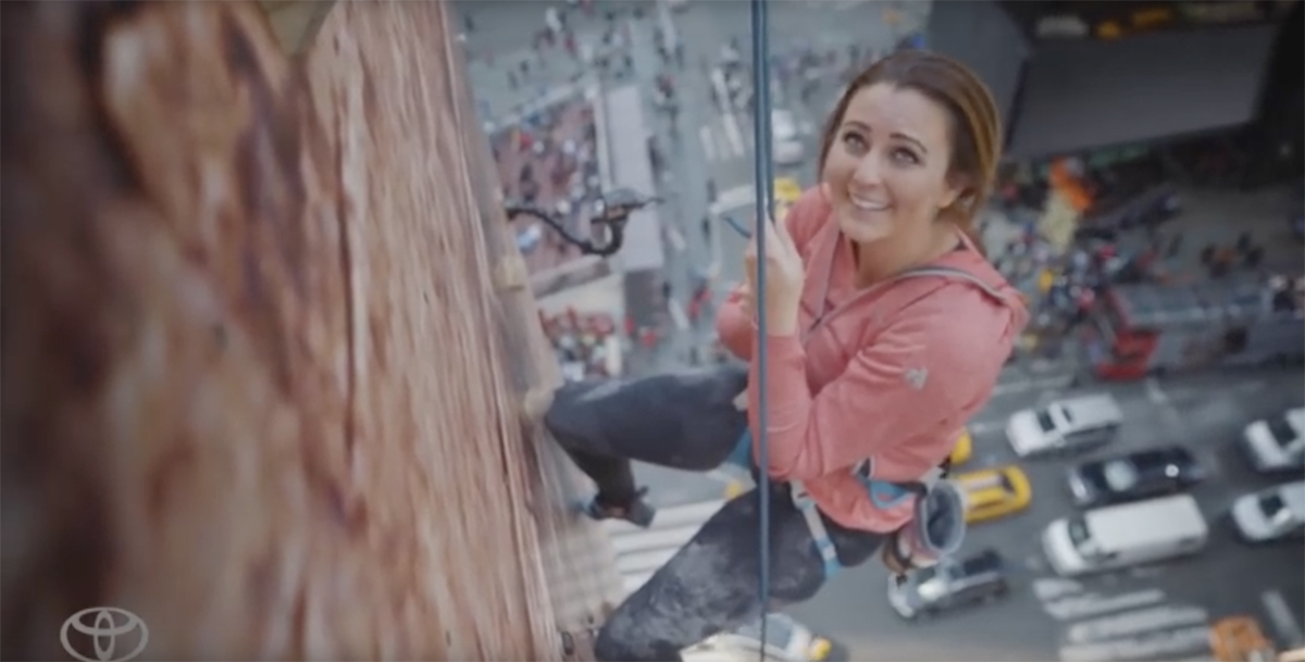 Toyota Hybrid climbing wall ad in Times Square