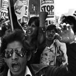 Bengali youths lead a demonstration. Brick Lane, London, 1978