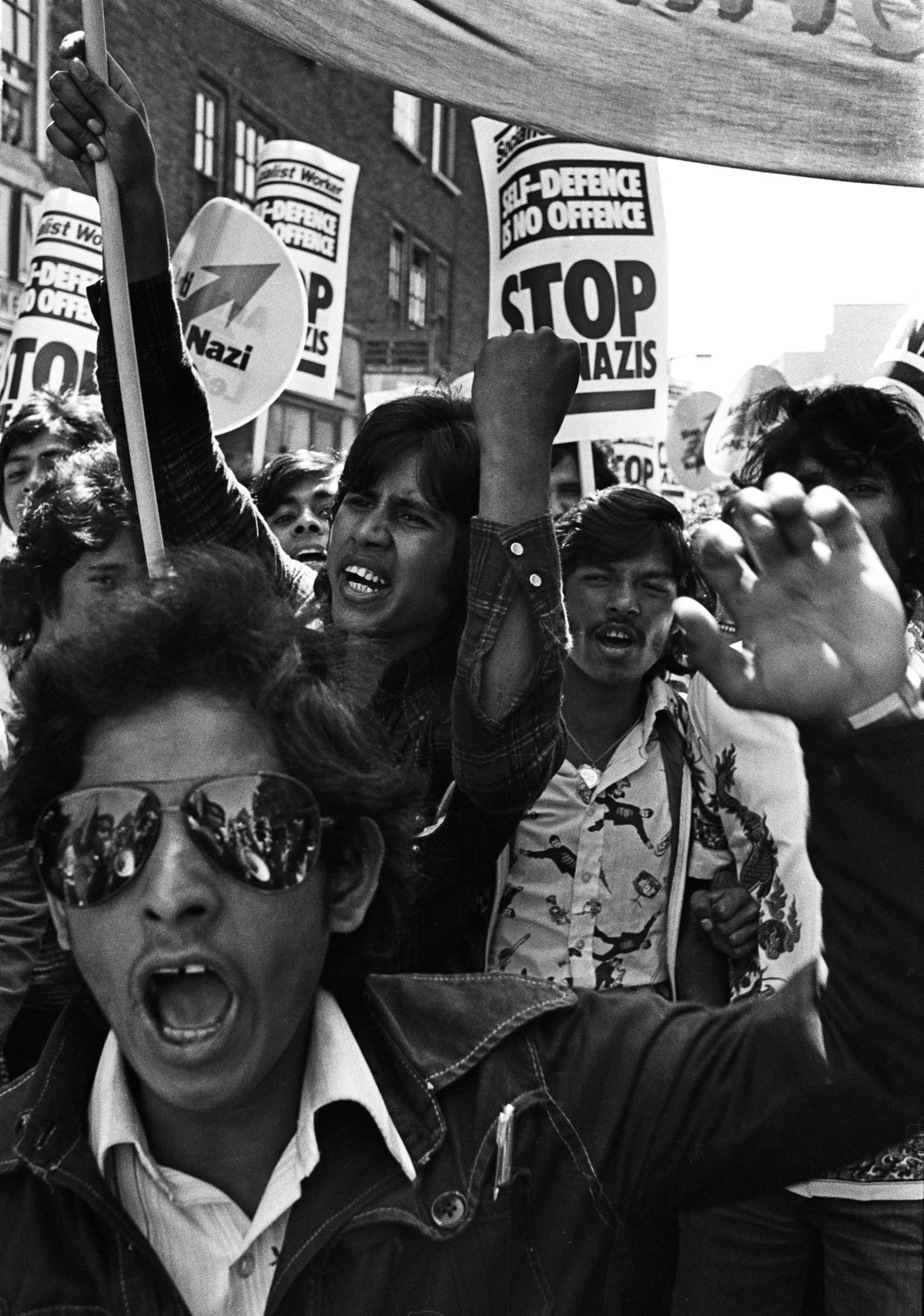 Bengali youths lead a demonstration. Brick Lane, London, 1978