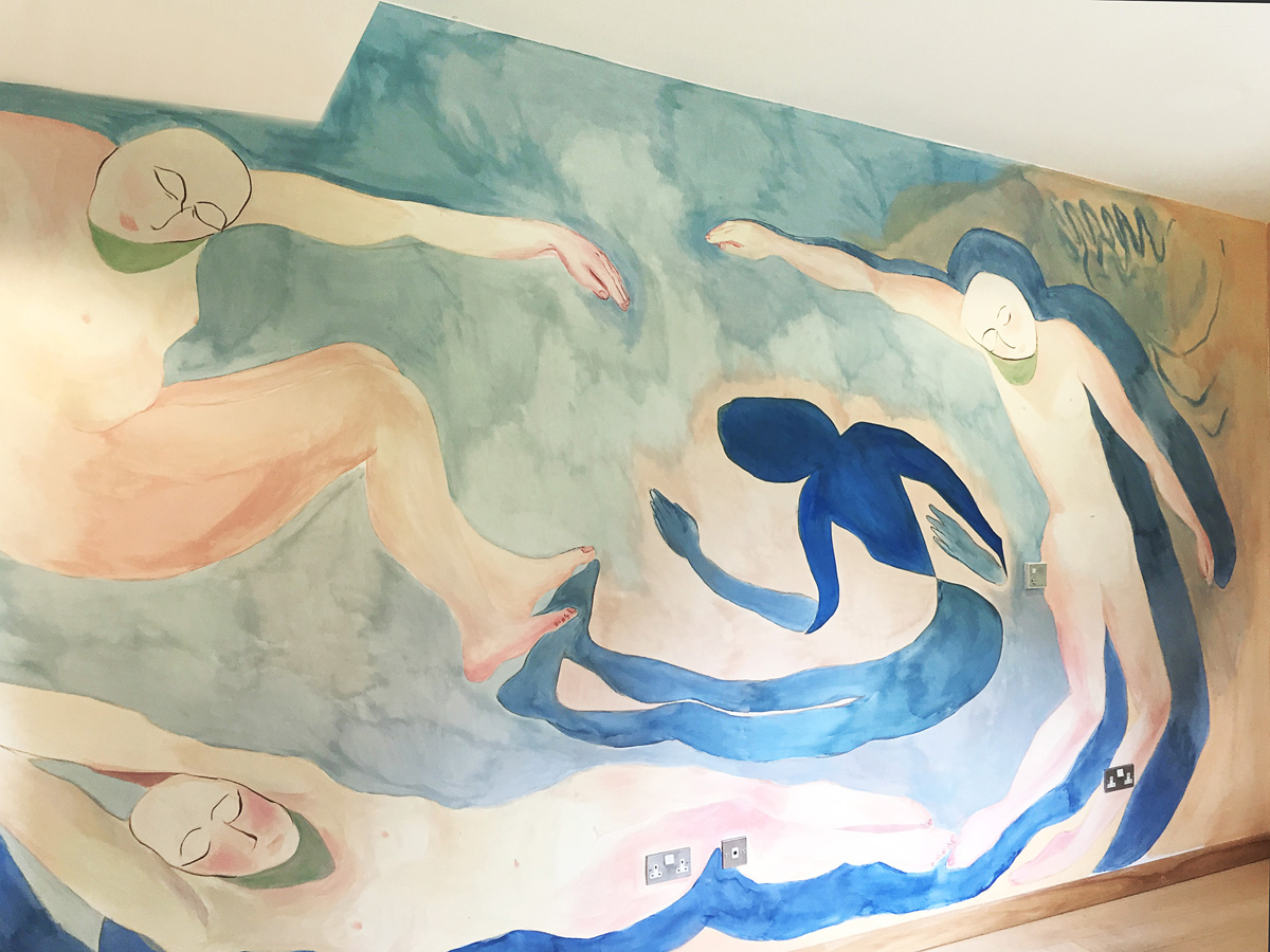 Aimee Parrott's mural for the women's lounge at Phoenix Unit, inspired by Matisse's Dance. Parrott also installaed plants in the room and created handmade curtains to match the existing sofas