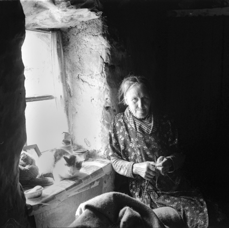 Woman in window, Harris, 1937. By Robert Moyes Adam. Courtesy of the University of St Andrews Library: RMA-H-5591.X