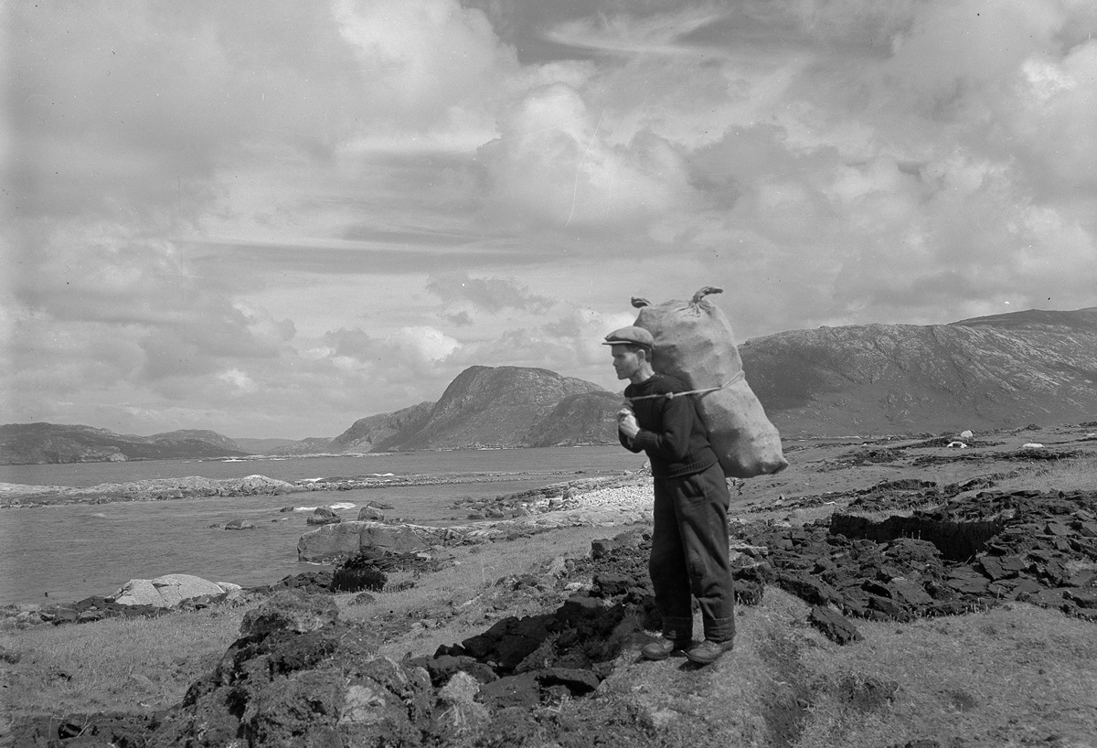 Carrying peats, Fladday, Harris, 1937. By Robert Moyes Adam. Image courtesy of University of St Andrews Library: RMA-H-5623