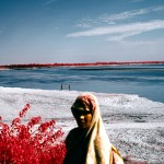 After the Red River Valley. (2012). India. 120mm CIR Photograph; Here infrared film reveals flood damage. All the soil appears white, which indicates that it is devoid of nutrients and life after the flood. Soil with healthy grass and vegetation typically appears bright red on colour infrared film.