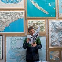Thomas Heatherwick holding Wallpaper magazine anniversary issue