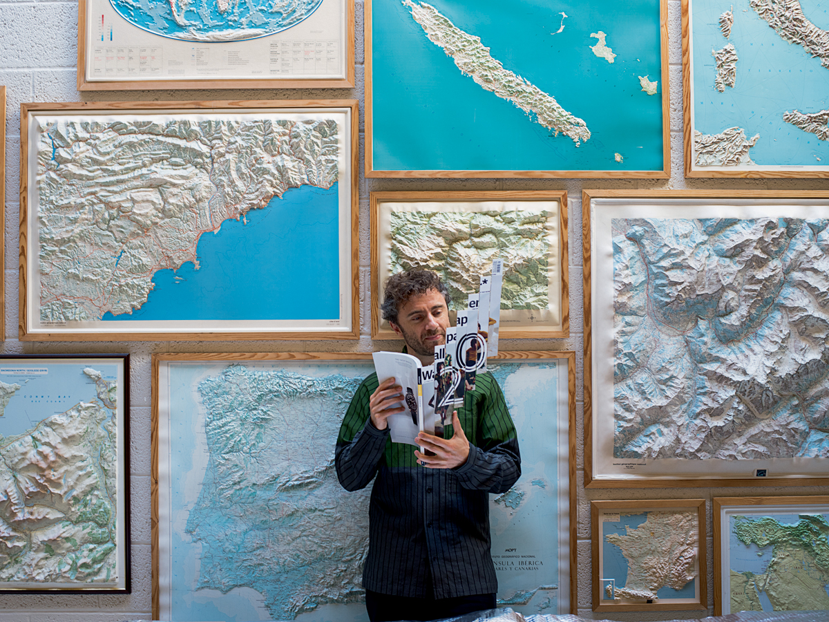 Thomas Heatherwick holding Wallpaper magazine anniversary issue