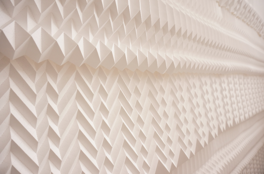 Refraction, an origami-inspired installation at 10 Thurloe Place by Kyla McCallum of Foldability. The installation was made using 200 paper panels and 52,000 folds