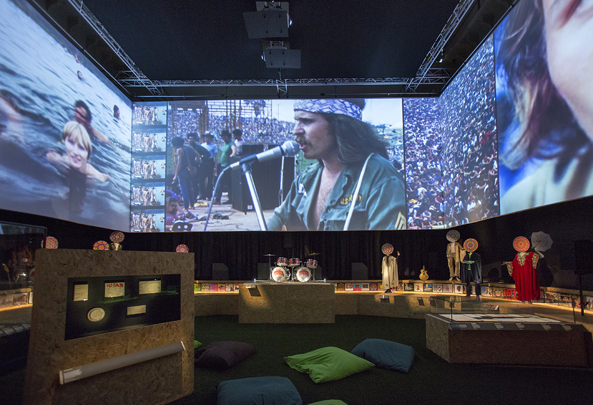 Footage from the Woodstock festival plays out in a room at You Say You Want a Revolution?