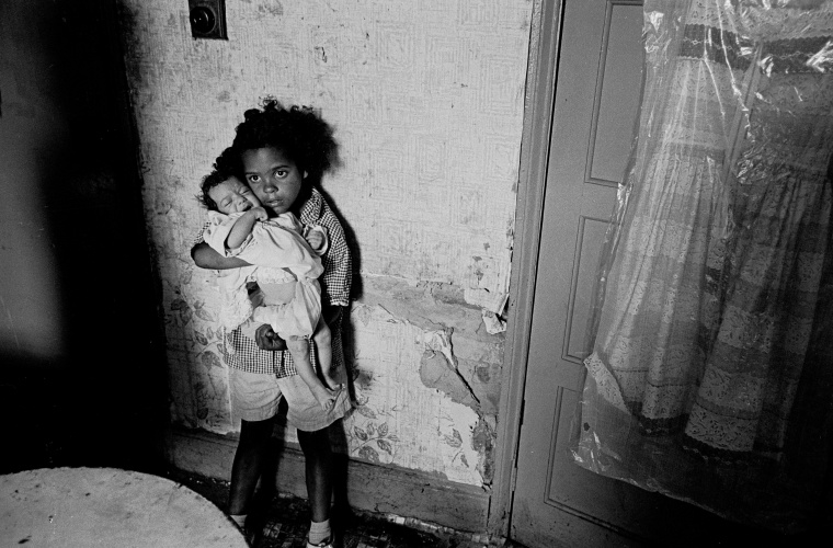 Photograph by Nick Hedges of two girls at a slum property in Birmingham, 1970