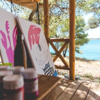 Rozalina Burkova's canvases at her forest lodge on Obonjan island