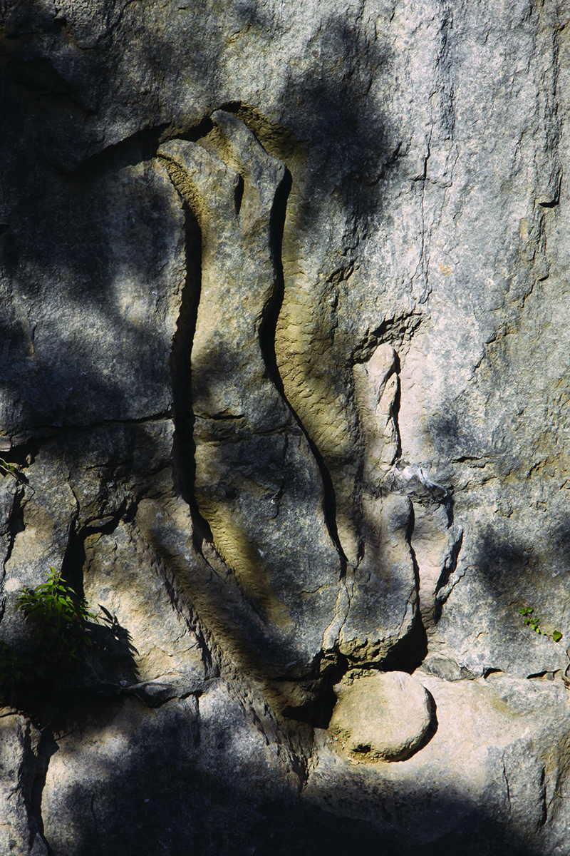 Sir Antony Gormley's Still Falling, carved into the rock face at Tout in 1983, the year the park opened