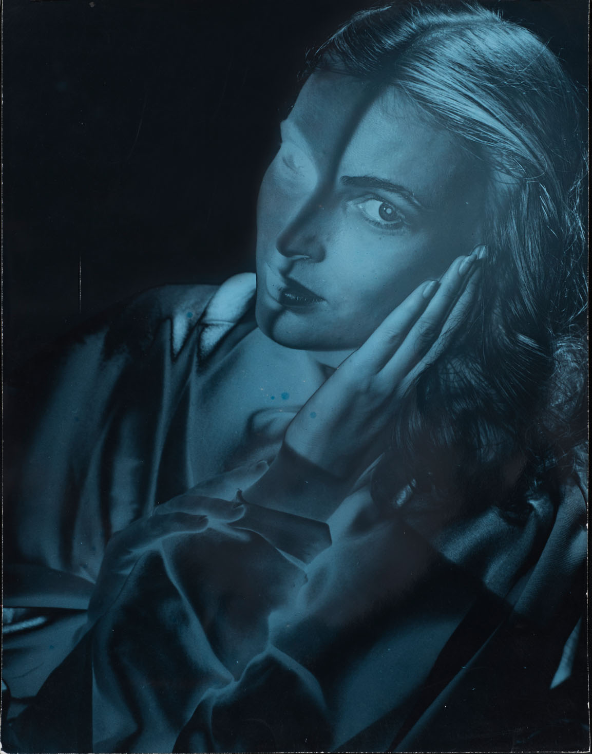 Erwin Blumenfeld, Dyed Blue Solarized model with Face on Hands, New York, 1946, Silver Gelatin Print, Courtesy Osborne Samuel