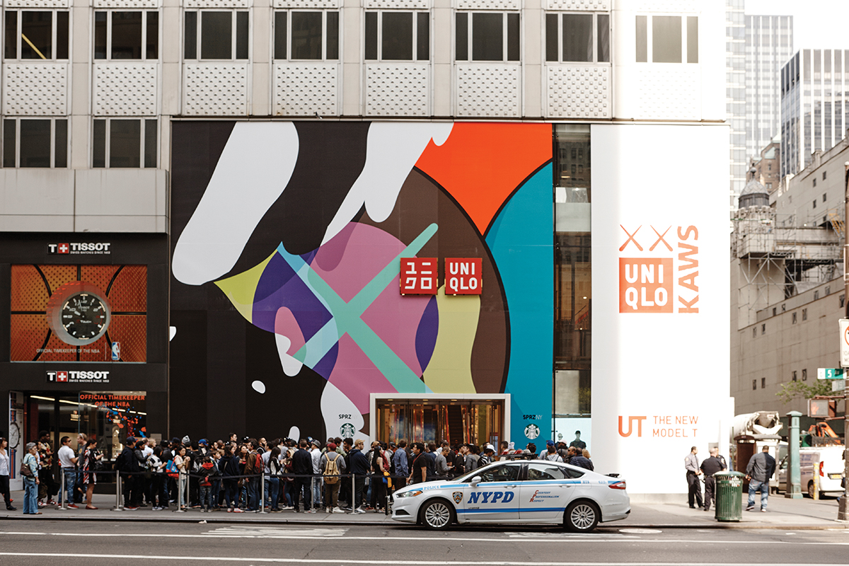 Window display in Soho, New York advertising the launch of the KAWS collection at Uniqlo. Photograph: Bec Lorrimer