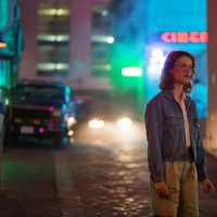 Black Mirror Still from San Junipero. The episode is set in a fictional world that looks like a 1980s film set