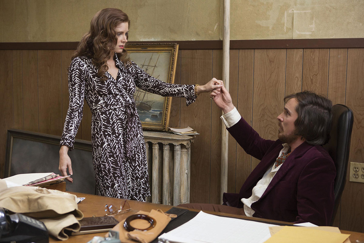 "Amy Adams' character Sydney Prosser wears a similar dress in American Hustle (2013). ""Prosser is trying to elevate her status.... She doesn't understand elegance or subtlety,"" says Laverty. (Atlas Entertainment/The Kobal Collection)"