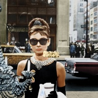 Edith Head's copy of Givenchy's rejected black dress for Breakfast at Tiffany's (1961). According to Laverty, the top half of the dress is almost identical to Givenchy's original (which featured on the poster art for the film), but accessorised with Tiffany diamonds and pearl necklace (Paramount/The Kobal Collection)