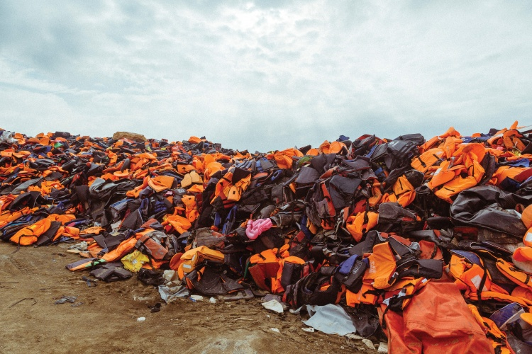 In the mountains above Molyvos, thousands of life jackets used by refugees are collected and dumped into a growing waste area. Known amongst NGO volunteers as the 'Life Jacket Graveyard', the site is a stark symbol of the hazards undertaken by thousands of refugees.