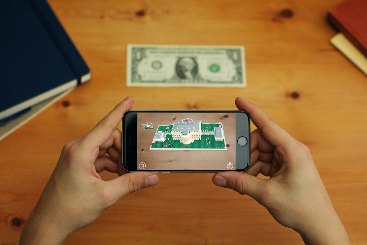 The AR experience is accessed using a free app and a dollar bill