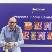 Street Artist Ben Eine customises welcome home banners for Christmas reunions