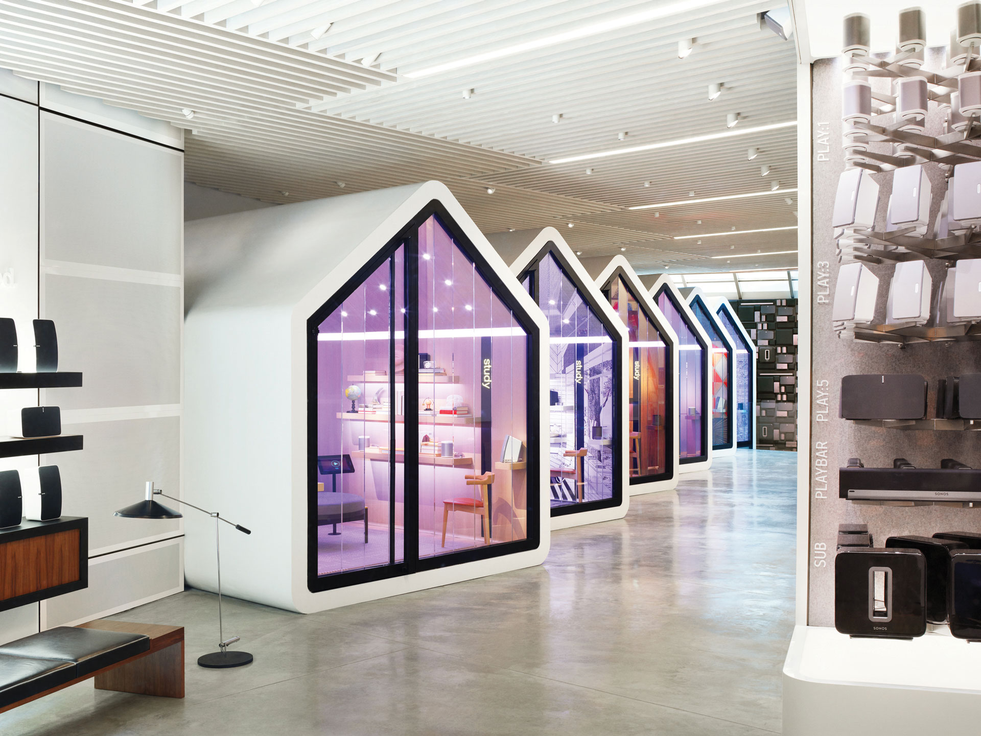 The Sonos store in Soho aims to replicate the experience of listening to Sonos products in the home via various listening rooms – the speakers adjust to the materials and space of a particular room