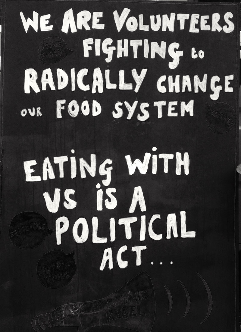 Café sign as used by The Bristol Skipchen, outlining the political nature of making use of waste food.
