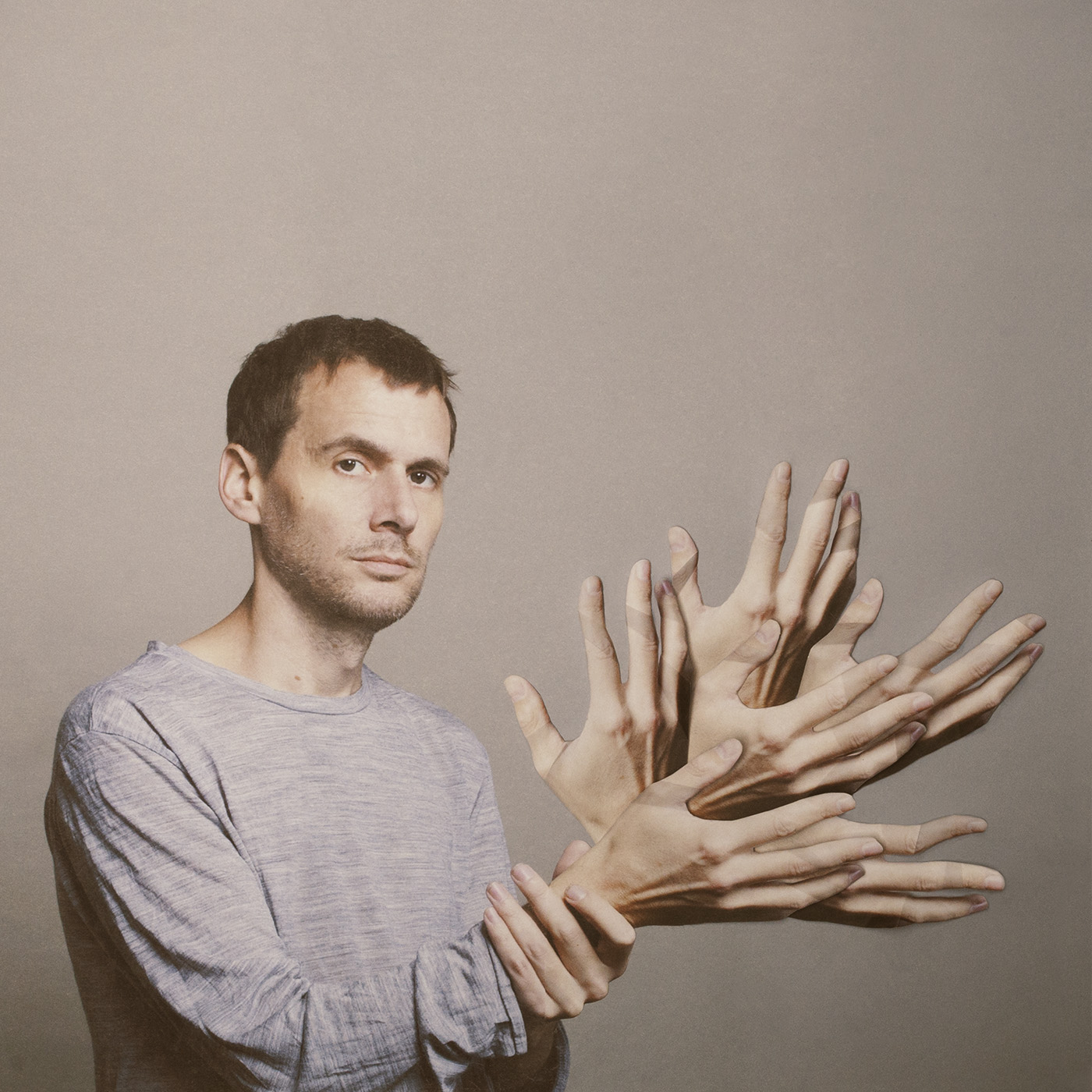Cover art for Clark's 2013 album Feast Beast. Haser created the cover image by printing out multiple images of Clark's hands and laying them on top of one another