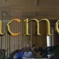 Two-tone window gilding for acme, an architecture and design studio based in Shoreditch. Made using 23-carat gold leaf in a mirrored and matte finish