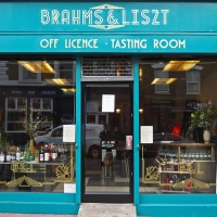 Shop fascia and window display for an off licence on Chatsworth Road, East London