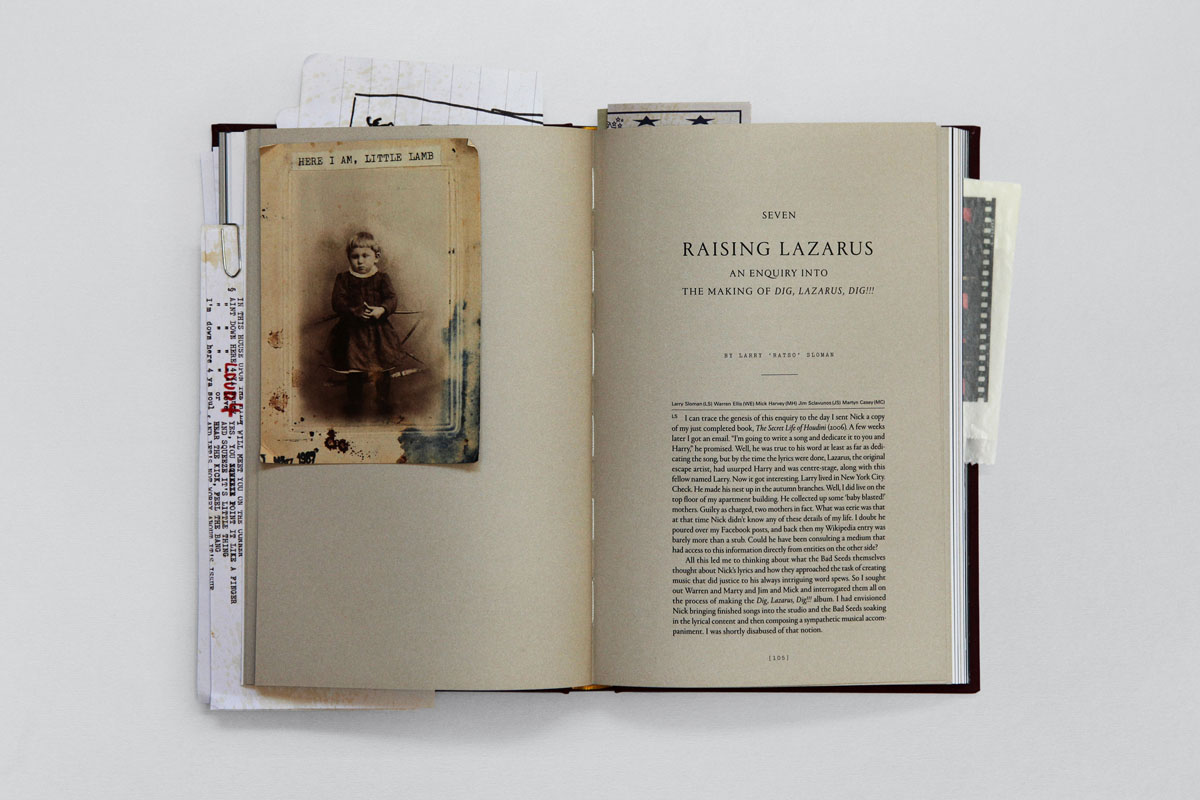 Loose photographs, drawings and printed ephemera are hidden within the pages of the book