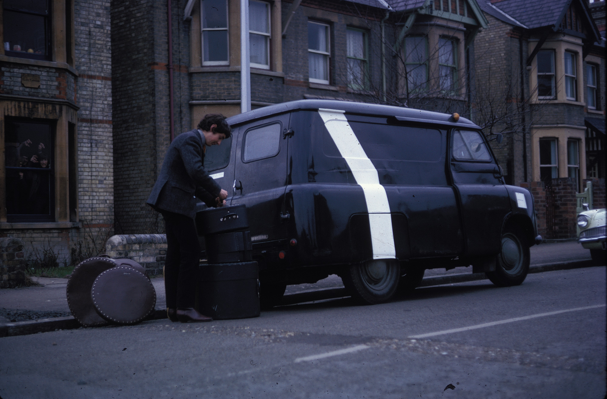 Nick Mason loading his drum kit into the Bedford van in 1965 on Rock Road, Cambridge. Image: Pink Floyd Archive