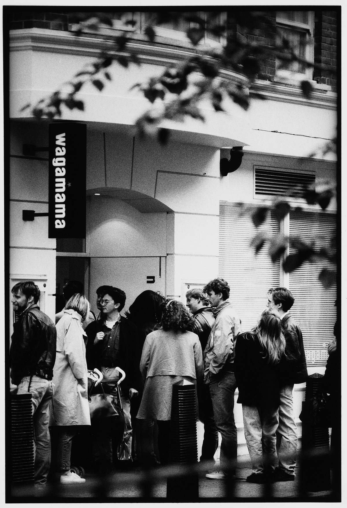 Diners queueing up at the opening of Wagamama's first restaurant in Bloomsbury in 1992. Images courtesy of Wagamama