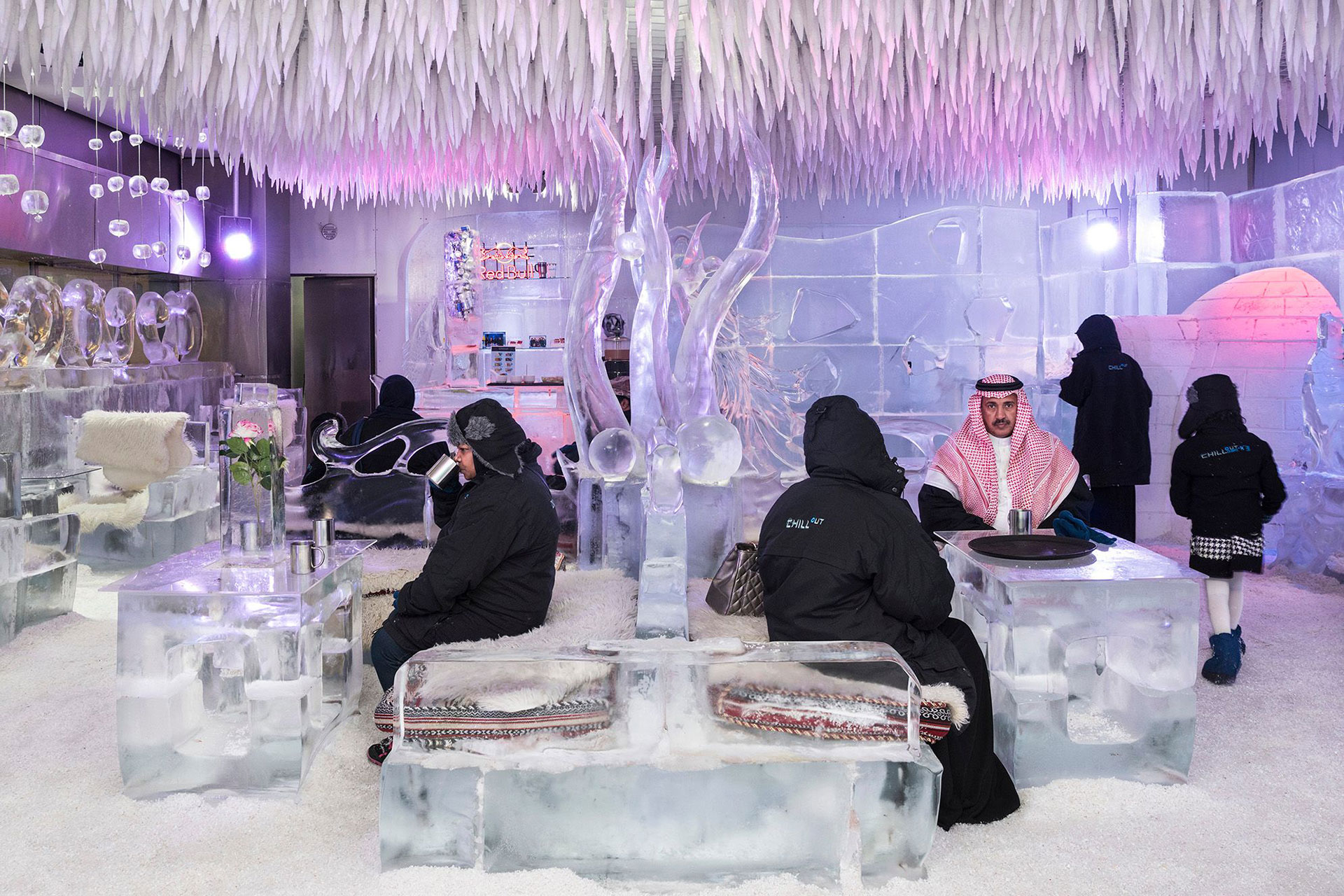 Chillout Ice Lounge, Dubai, January 2016. Saudi tourists having a hot chocolate at the Chillout Ice Lounge, the first ice lounge in the Middle East. Complete with ice sculptures, ice seating and tables, all at a subzero temperature. © Nick Hannes.