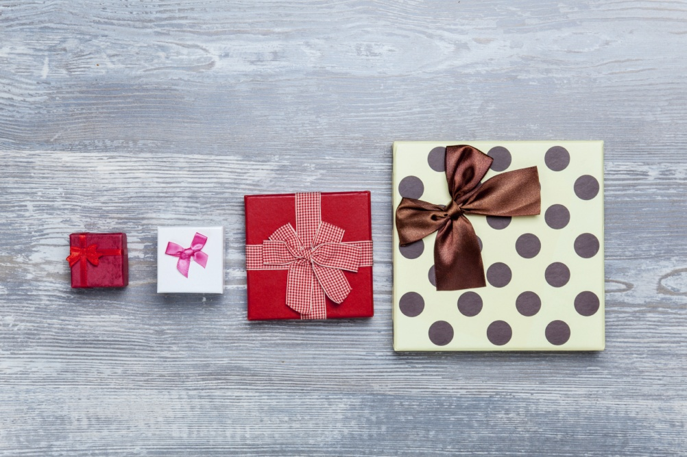four gift boxes on a table.