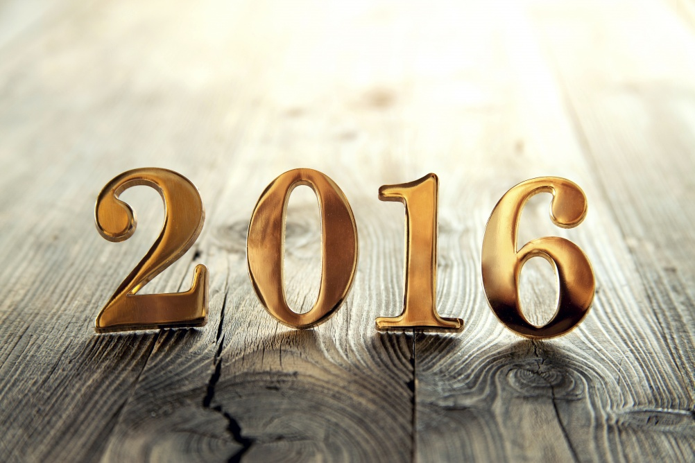 Gold 2016 new year text on a wooden background