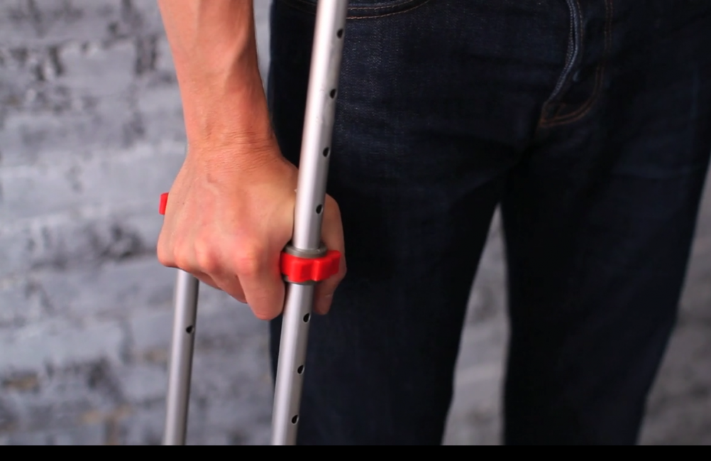 An axillary crutch, which supports via the wrist and underarm