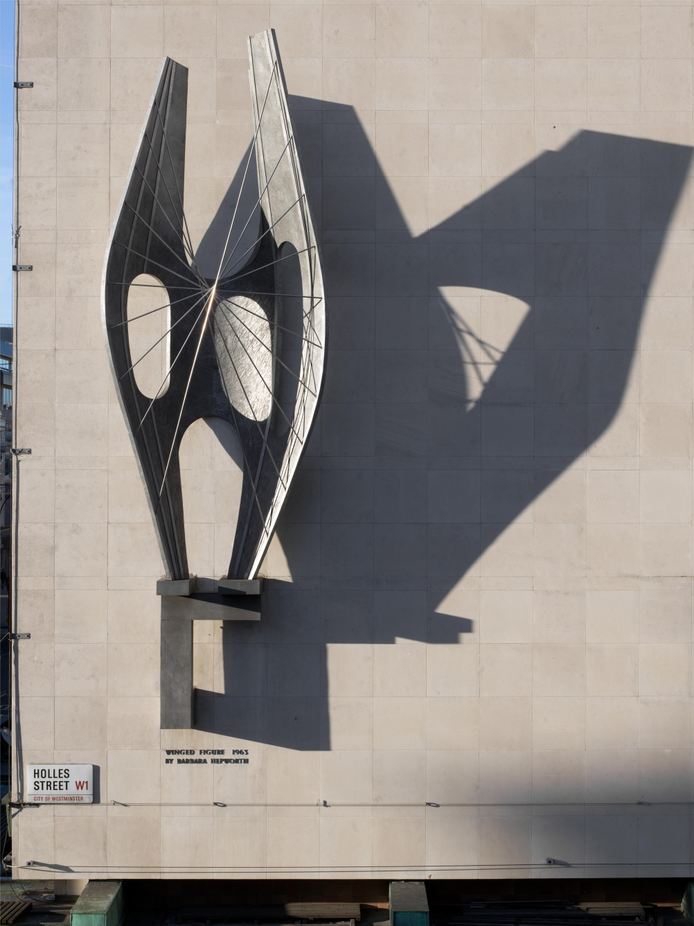 "Winged Figure by Barbara Hepworth, Oxford Street, London, 1963. Listed Grade II* One of Hepworth's most important works this is an Oxford Street landmark. Unusually, it is in the same position and context for which it was originally intended as a commission for the John Lewis store. Through it Hepworth said she wanted to evoke a sensation of freedom: ""if the figure in Oxford Street gives people a sense of being air-bourne in rain and sunlight and nightlight, I will be very happy"". © Historic England"