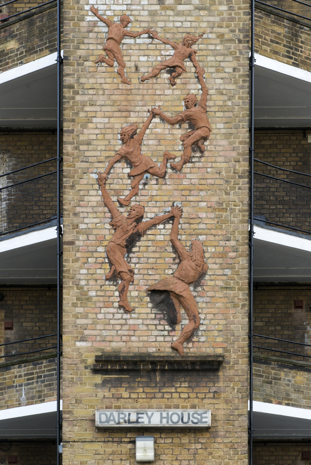 Following the Leader (Memorial to the Children Killed in the Blitz) by Peter Laszlo Peri, Vauxhall, London, 1949. Listed Grade II A poignant dedication to the children who lost their lives in the Blitz, this sculpture is an early example of the Hungarian artist Peri's work and one of three unusually commissioned for social housing estates in South Lambeth by London County Council (LCC). The cascading figures of children holding hands are cast in coloured concrete- an innovation which Peri was known for. He is an underrated artist who intended for his pieces to brighten up the environment of the people who lived beside them. © Historic England