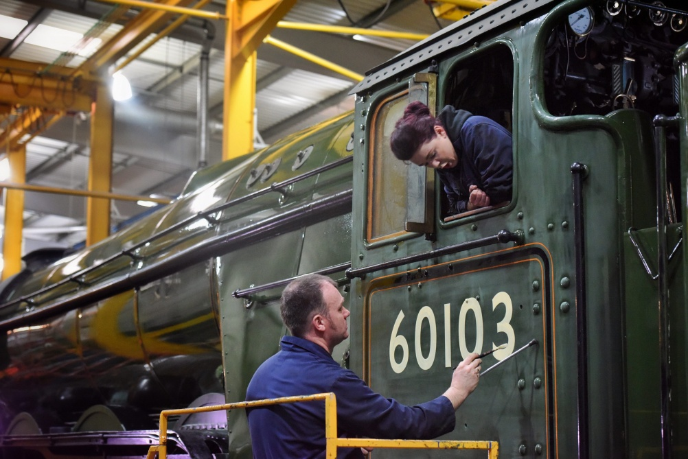 Mike O'Connor applies-Flying Scotsman's iconic number, watched by his daughter Teriann (Credit: Paul Kingston)